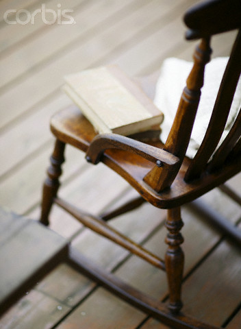 Empty Rocking Chair on a Deck